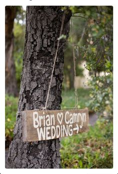 Decor - like this rustic sign hanging on a tree