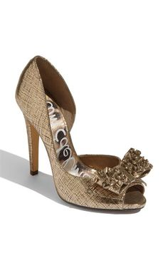 Love a half d'orsay, add to it textured leather and a studded bow! I won't go for the obvious pun, but I do adore these.