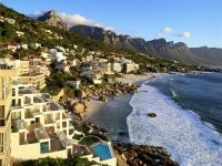 Cape Town, South Africa Photograph by Steve Bloom/Getty Images The seaside resort of Clifton, near Cape Town, hugs the western slope of Table Mountain. Dream Vacations, Vacation Spots, Vacation Travel, Oh The Places You'll Go, Places To Travel, Travel Destinations, Vancouver Photos, Clifton Beach, Le Cap