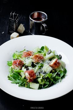 Salad with Chicken Breast wrapped in Prosciutto, Melon, Celery Root and Roasted Pumpkin Seeds
