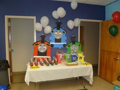 thomas the train themed birthday party | Thomas the Train / Birthday / Party Photo: Favor table. Trains made ...