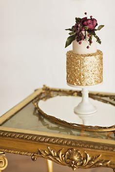 gold wedding cake with marsala flowers