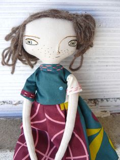 Doll made in linen and cotton. The doll has hair made of alpaca and silk sewn by hand stitch by stitch. The face, also embroidered by hand. It is perfect to hang on the wall, sitting, or decorate every corner. Her size is about 32 cm. Not suitable for children under three years old.