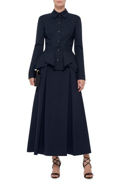 Early 20th century zoot suit inspirations infused the king of drama's polished eveningwear and separates with a relaxed sense of ease and femininity this season. Crafted in stretch cotton poplin, this long sleeved **Zac Posen** shirt exudes refined elegance in a button up silhouette, with architectural peplum pleats at the waist.