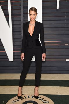 She completed her sleek, tailored Dolce & Gabbana suit with Forevermark diamonds and Christian Louboutin heels at the Vanity Fair Oscar Party.