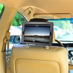 iPad Car Headrest Mount | This is the perfect way to keep kids entertained on long car rides. Find one here for $25.99.