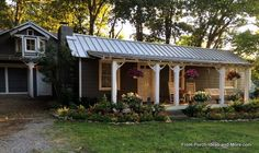 The shed style metal porch roof is somewhat of an extension of the home's roof.