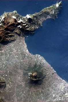 Vesuvius,: Surrounded by metro Naples. as seen from the International Space Station. Herculaneum is on the coast nearest the mountain, Pompeii is at about a mountain's width at 11 o'clock. Earth And Space, Voyage Rome, Monte Fuji, Pompeii And Herculaneum, Space Photos, Carthage, Space Station, Aerial Photography, Travel Photography
