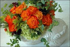 Orange & Green- 'Circus' roses, solidago, bupleurum, green hydrangeas, orange ilex berries, smokebush and wheat