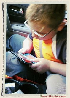 This is what Kyle does while in the car… playing video games…. & he wonders why he gets headaches in the car? 2012 #AuntHeather
