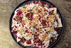 This is a subtly textured, richly flavoured arrangement of toasted pieces of flatbread topped with meaty aubergine and beef, a garlicky tahini-yogurt sauce, red pepper flakes, pomegranate seeds, toasted pine nuts and fresh shredded mint. I think of this rather as a refined, Middle-Eastern form of nachos.