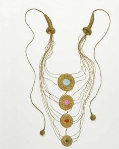 "crochet gold necklace Edgy 1970s Crochet RUTH NIVOLA-DE/USA ""Ruth Nivola grew up in Europe before settling in the U.S. in 1939 at the outbreak of World War II. Her mixed-media jewelry, such as Tre Re Maggi, combines sculpture with ornament. She recycles non-precious materials such as buttons, fabric, and metallic threads to create contemporary jewelry. Tre Re Maggi reminds us of the spiritual power that ornament once had.  """