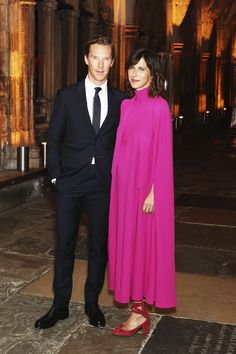 Benedict Cumberbatch in a Valentino suit with his wife Sophie Hunter, in a Valentino Spring/Summer 2017 fuchsia cape dress, at the Doctor Strange premiere in London.