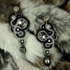 Beautiful Silver Night Swarovski crystals surrounded by a black, gray and silver ribbons of soutache, will add a flash of each creation. Earrings are very lightweight, beige lined recipes the bottom leather, impregnated on both sides, hooks are non-allergenic.    AVAILABLE