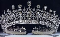 The Fife Tiara: It first belonged to Princess Louise of Wales, the oldest daughter of King Edward VII and Queen Alexandra. When she married the Earl of Fife in 1889, she received this stunning tiara with pear-shaped diamonds hanging freely in a diamond framework, topped with more pear-shaped diamonds alternating with round diamonds. Her parents' gift was a classic convertible diamond fringe tiara. Via The Royal Order of Sartorial Splendor.
