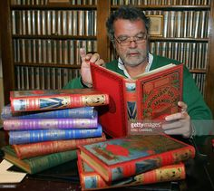 Philippe Jauzac, author of 'Jules Verne - Hetzel et les cartonnages illustres' (Jules Vernes and the Hetzel illustrated covers) reads a copy of 20,000 Leagues Under the Sea, surrounded by his personal collection 25 January 2006 at his home in Toulouse, south western France. Jauzac, a professor of medecine and deputy general secretary of the Jules Verne's foundation wrote 'Jules Verne - Hetzel et les cartonnages illustres', a reference on Jules Verne editions showing most publications…
