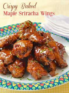Crispy Baked Maple Sriracha Wings - Forget the fryer! You'll never miss it when you try these oven baked, crispy coated chicken wings that get tossed in a simple, sweet, sticky, spicy, maple sriracha glaze. Sure to be the hit of any Superbowl Party or any game day get together.