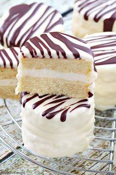 Infused with vanilla flavor and coated in white chocolate with dark chocolate stripes, these made from scratch copycat zebra cakes are dangerously good! From @roxanasbaking