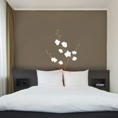 Spare bedroom ideas...plain white linen always looks great with dark walls, a neutral colored drape or even blinds , and introduce colour with cushions etc