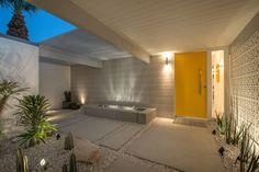 Concrete doors entry midcentury with concrete slabs yellow front door
