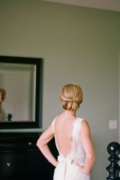 This low #chignon is wedding day perfection! Photo by Jen Lynne Photography
