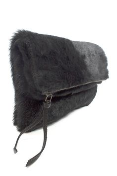 This ultra luxe Goat Hair Foldover Clutch is the perfect finish to any holiday look!
