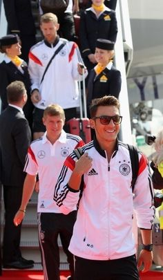 Die Mannschaft arriving back in Berlin! Welcome home champions!! :D