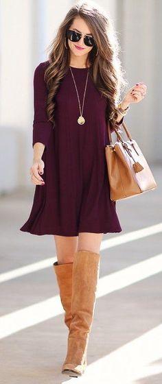 Burgundy dress with tan handbag and OTK boots.