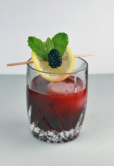 A refreshing blackberry bourbon lemonade recipe with a kick! Bourbon whiskey is paired with ripe blackberries, lemons and muddled mint perfect for summer!