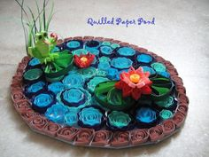 DIY Quilled paper pond Video and Printable step by step instruction! Imagine the delight when a birthday child sees this side-by-side on their birthday table!  Great conversation piece, decor, quilling, pond, frog, DIY, birthday, hostess, gift, shower....