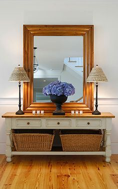 Foyer ideas...like the mirror and table, maybe a coat rack off to the side
