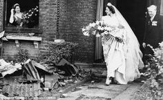Dancer Ena Squire-Brown leaves her bombed home on the day of her wedding