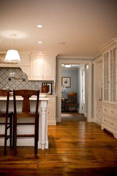 the floor, white cabinets, blue backsplash. beautiful