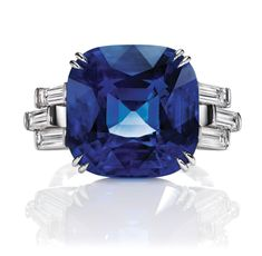 Sunset by Harry Winston, Sapphire (18.51 carats) and Diamond (1.25 total carats) Ring in a platinum setting.