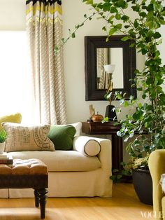 .so fresh.  see other room views on the link - the blue tufted Martha chair is a nice pop
