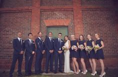Not sure if i like so much navy, but i like the groom in the navy with the bridesmaids...maybe put groomsmen in charcoal/black suits