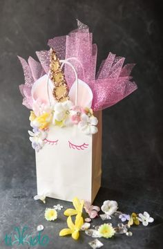Turn a plain white paper gift bag into this magical unicorn and make gift-giving even more enchanting.