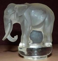 Rene Lalique Paperweight Toby Elephant 9 centimeters tall clear and frosted Lalique Paperweight Elephant on rounded base Model: 1192 Circa 1931