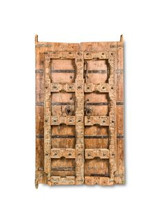 This antique door is the epitome of innovative art pursued during ancient India, a time when all crafts were revered. This antique has survived for a long time, owing to its solid construction. Durable to the hilt, it features two panels, constructed in recessed blocks with satin finish throughout the construction. The door hails from the ancient culture of India—the … Indian Doors, India Culture, All Craft, Wood Doors, Satin Finish, Old World, Survival, Carving, Construction