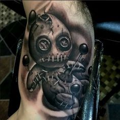 Little black and white creepy voodoo doll tattoo on arm - Tattooimages ...