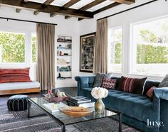For director, writer and producer Marc Webb's Los Angeles home, designer Vanessa Alexander placed a custom low- slung chesterfield sofa covered in Rogers & Goffigon velvet and a coffee table from RH on a vintage Moroccan carpet from Woven Accents in the living room.