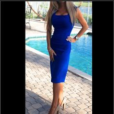 """Sexy pinup """"Ella Blue"""" dress by Bettie Page This curve hugging dress is made of a stretch bengaline and has a """"twisted gather"""" design across the bust line. This dress is currently selling on the Tatyana website for $125. Bettie Page by Tatyana Dresses"""