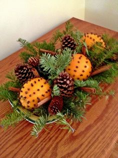 Pomanders (oranges studded with whole cloves), balsam sprigs, cinnamon sticks, and pine cones...