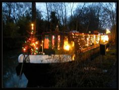 Festive Canal Boat christmas tree lights  narrow  boat