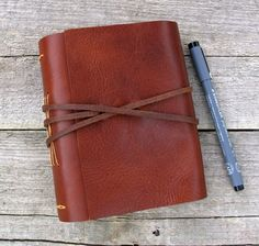 """Leather journal, """"The world is a book, and those who do not travel read only a page"""", travel journal by moon and hare by MoonAndHare on Etsy"""