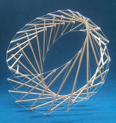 None of the sticks touch. Tensegrity by Marcelo Pars.