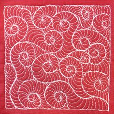 Leah Day's Flickr collection of her free motion quilting project here.  Fossil Snail - Day 32 by Leah Day, via Flickr