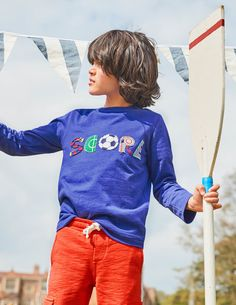Love sport? Keep it close to your heart with this fun appliqué T-shirt. A bold design on the chest with embroidered details tells the world you adore getting active. And the stretchy cotton jersey is perfect for running and jumping. With jeans and a zip hoodie, it's a winner.