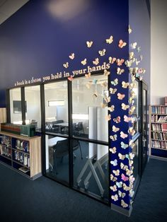 A book is a dream you hold you in your hands #library #librarydisplay #bulletinboard #schooldisplay #educators #booklove #libraries #butterflies #papercraft #paperbutterflies #bookpages School Displays, Library Displays, Magical Library, Paper Butterflies, Book Pages, Libraries, Hands, Mirror, Books