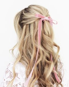 long curls with a pink bow